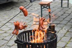 Grilling Season, roasting sausages, farmers market, people roast sausages. Stock Image