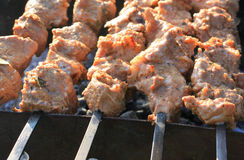 Grilling shashlik on barbecue grill. Juicy pork Stock Photography