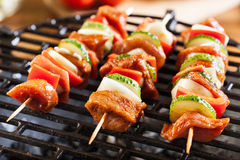 Grilling shashlik on barbecue grill Stock Photography