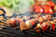 Grilling shashlik on barbecue grill Royalty Free Stock Photos