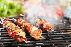 Grilling shashlik on barbecue grill Royalty Free Stock Photo