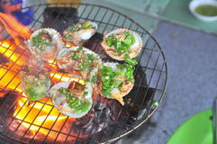 Grilling shellfish and seafood on hot fire Stock Images