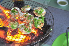 Grilling shellfish and seafood on hot fire Stock Photos