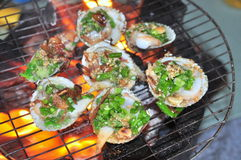 Grilling shellfish and seafood on hot fire Stock Photo