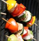Grilling shishkabobs Stock Photography