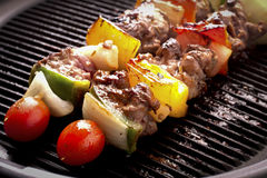 Grilling skewers barbecue. With meat and vegetables on electric grill Royalty Free Stock Images