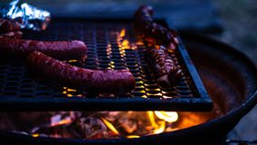 Grilling some sausages and cheese on fire!. I love those summer feels royalty free stock photography