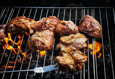 Grilling spiced chicken royalty free stock image