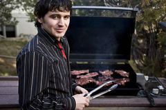 Grilling steak Stock Photography