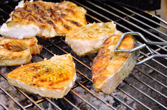 Grilling steak from fish royalty free stock photography