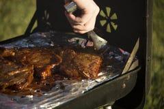 Grilling Steak Royalty Free Stock Photos