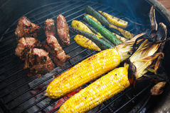Grilling steak, vegetables Stock Images