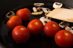 Grilling Strip Loin Steak Series: Mushrooms and Tomatoes Royalty Free Stock Photo