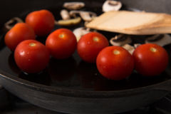 Grilling Strip Loin Steak Series: Mushrooms and Tomatoes Royalty Free Stock Images