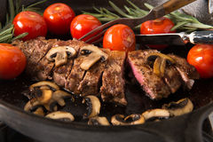 Grilling Strip Loin Steak Series: The Steak is Ready and Sliced Royalty Free Stock Image