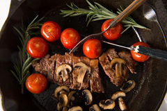 Grilling Strip Loin Steak Series: The Steak is Ready and Sliced Stock Photos