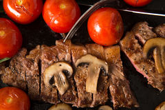 Grilling Strip Loin Steak Series: The Steak is Ready and Sliced Royalty Free Stock Photos