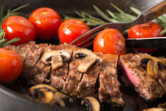 Grilling Strip Loin Steak Series: The Steak is Ready and Sliced Stock Photo