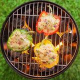 Grilling stuffed savory bell peppers on the BBQ Royalty Free Stock Photo