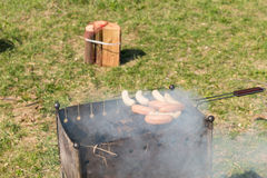 Grilling Tasty Meat Sausages on Barbecue Grill Royalty Free Stock Photo