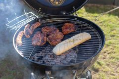 Grilling time! Grill, garden, green grass and good weather stock photo