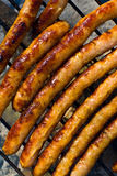 Grilling up Sausages Royalty Free Stock Images