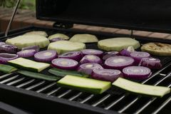 Grilling vegetables on a outdoor barbecue royalty free stock photo
