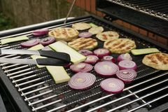 Grilling vegetables on a outdoor barbecue stock images