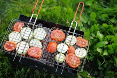 Grilling vegetables on pans Stock Photography