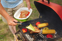Grilling vegs and sausages Stock Images