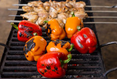 Grilling Whole Peppers and Kebabs on BBQ Grill Stock Photos