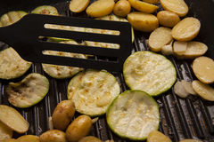 Grilling zucchini Royalty Free Stock Image