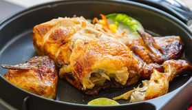 Grills chicken on the pan. Royalty Free Stock Images
