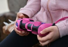 Grils hands holding children`s camera. Girls hands holding children`s pink camera Royalty Free Stock Images