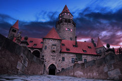 Grim castle. Haunted castle insertion into the dramatic environment Royalty Free Stock Photography