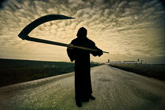 Grim Reaper. On the road royalty free stock image