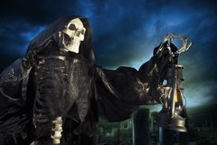 Grim reaper/ angel of death with lamp at night royalty free stock photo
