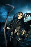 Grim reaper/ angel of death with lamp at night royalty free stock photos