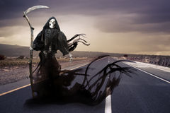 Grim reaper/ angel of death on a meadow stock images