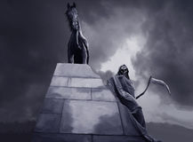 Grim reaper and black horse Royalty Free Stock Images