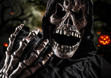 Grim reaper on a dark background Royalty Free Stock Photography