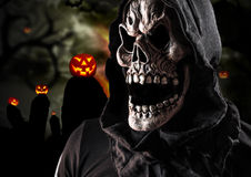 Grim reaper on a dark background Stock Images