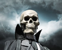 Grim reaper. death's skeleton on a cloudy sky. Grim reaper. death's skeleton on a cloudy dramatic sky Royalty Free Stock Photography