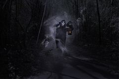 Grim Reaper in forest,Halloween day,Ghost puppet.  royalty free stock images