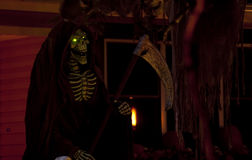 Grim Reaper with Glowing Green Eyes. Grim reaper with scythe and glowing green eyes Stock Images