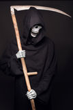 Grim reaper. Studio portrait on black background Stock Photo