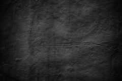 Grim wall texture, dark background black cement. Gloomy wall, dark background black cement texture royalty free stock images