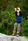 Grimace. Little boy standing on a stone and grimacing Royalty Free Stock Photos