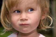 Grimace. Close up of a young girl who makes a grimace Stock Image