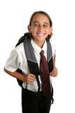 Grimace de garçon d'école Image stock